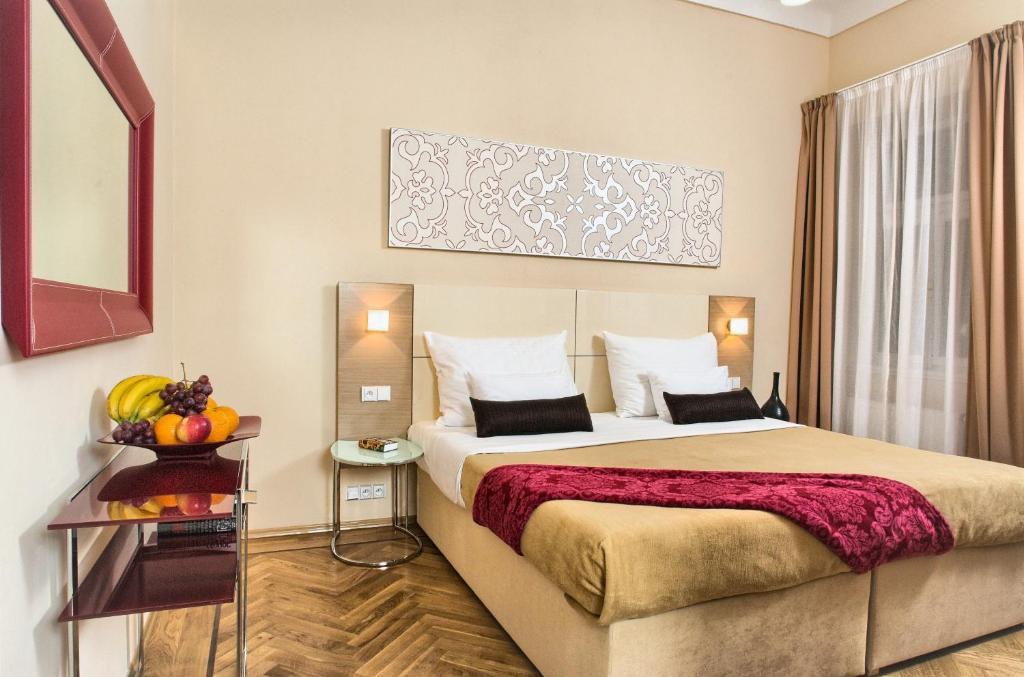 Postel nebo postele na pokoji v ubytování Residence Karolina