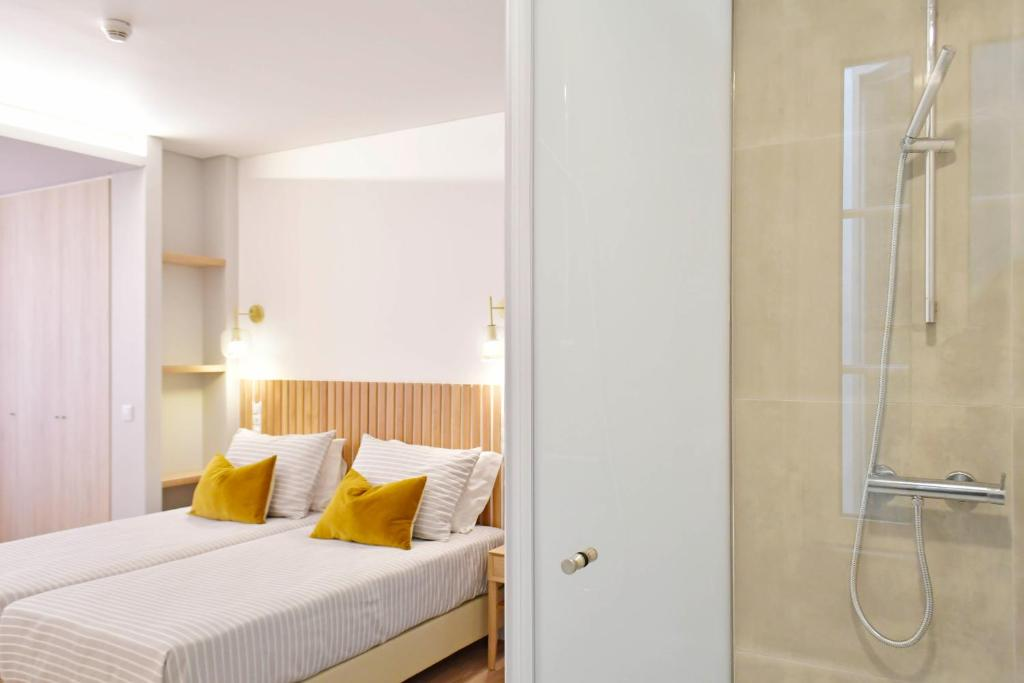 A bed or beds in a room at Residencial Fortunato
