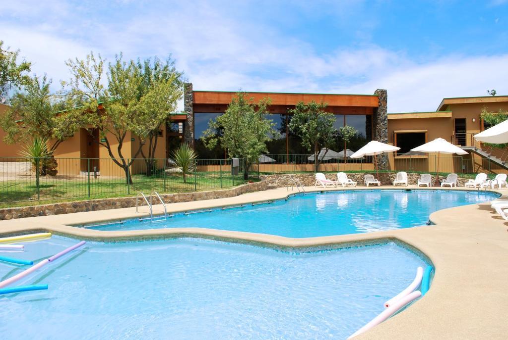 The swimming pool at or near Olmue Natura Lodge & Spa