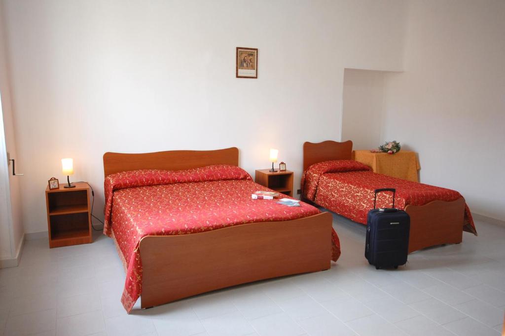 A bed or beds in a room at Albergo Del Santuario
