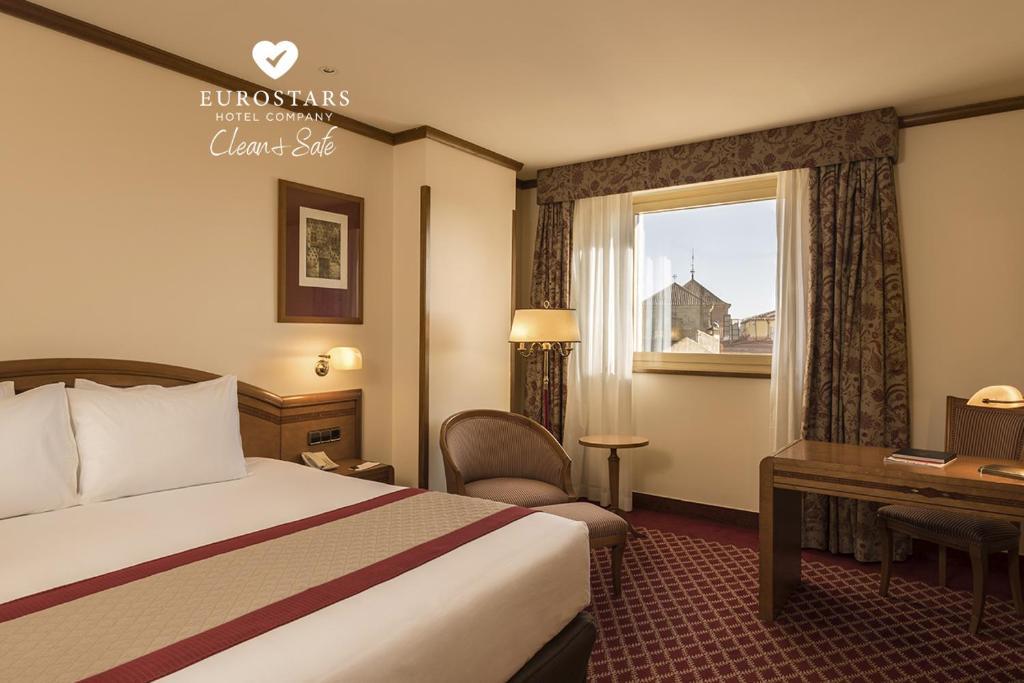Кровать или кровати в номере Eurostars Las Claras
