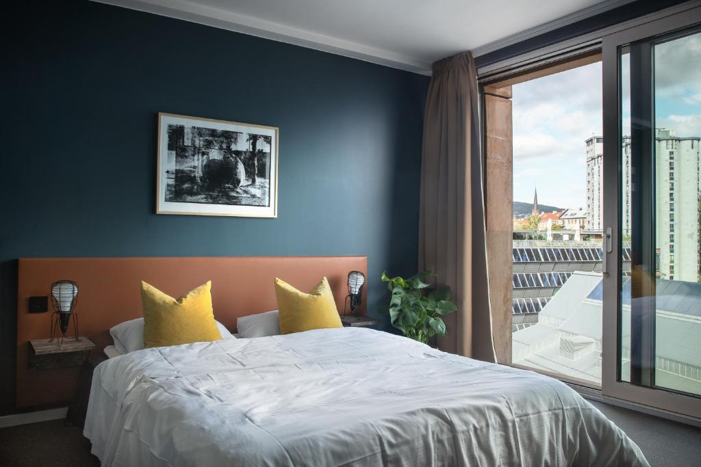 A bed or beds in a room at PS:hotel by Nordic Choice