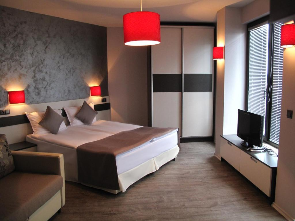 A bed or beds in a room at Gran Via