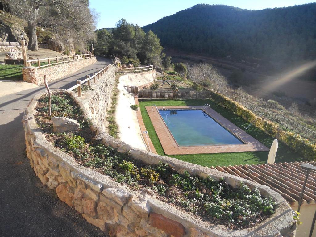 Vista de la piscina de Masía Puigadoll o d'una piscina que hi ha a prop