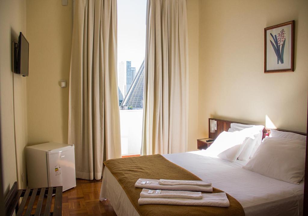 Cama ou camas em um quarto em Hotel Carioca