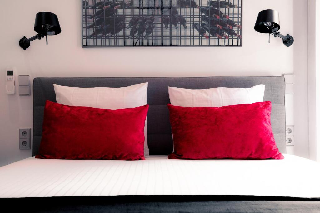 A bed or beds in a room at Boutique Hotel ZIES