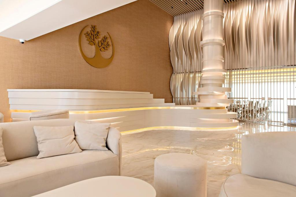 A seating area at Green Suites Boutique Hotel