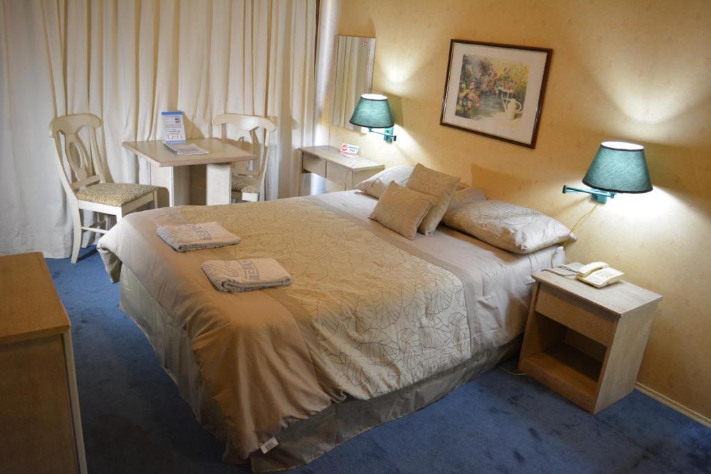 Cama o camas de una habitación en Hotel Solar del Acuario