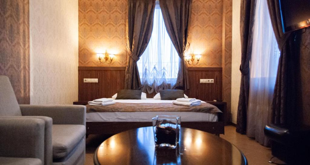 A bed or beds in a room at Broadway Hotel Moscow