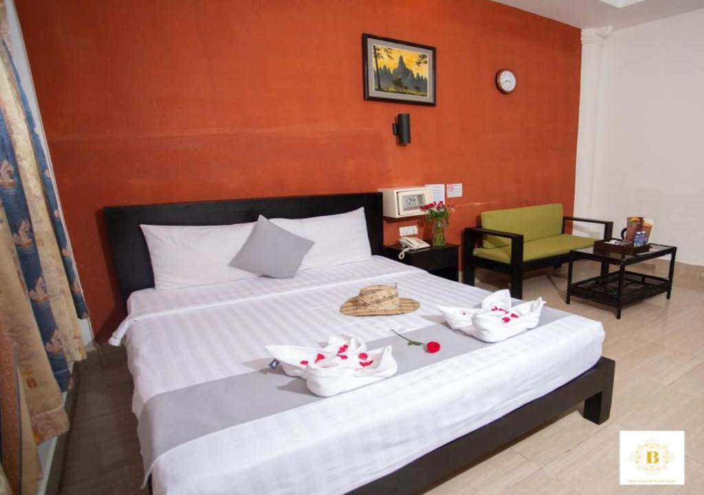 A bed or beds in a room at Best Central Point Hotel