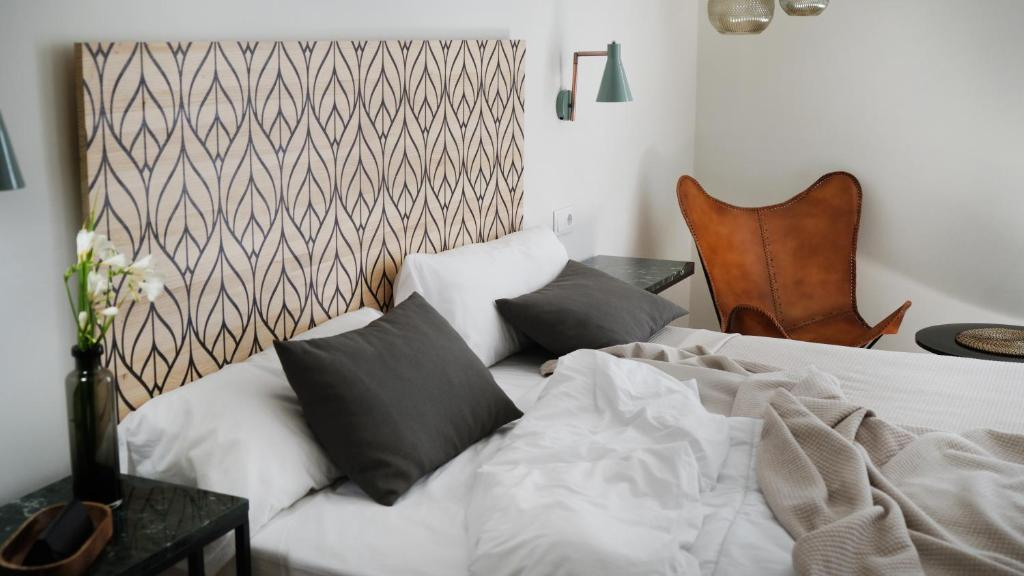 A bed or beds in a room at MD Design Hotel - Portal del Real
