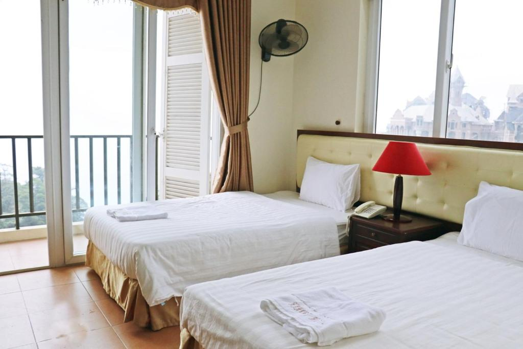 A bed or beds in a room at Hanvet Tam Đảo Hotel