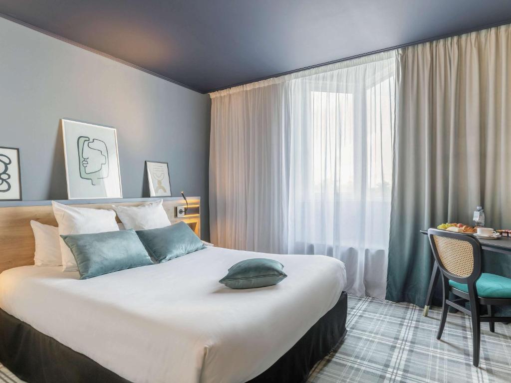 Un ou plusieurs lits dans un hébergement de l'établissement Mercure Lyon L'Isle d'Abeau