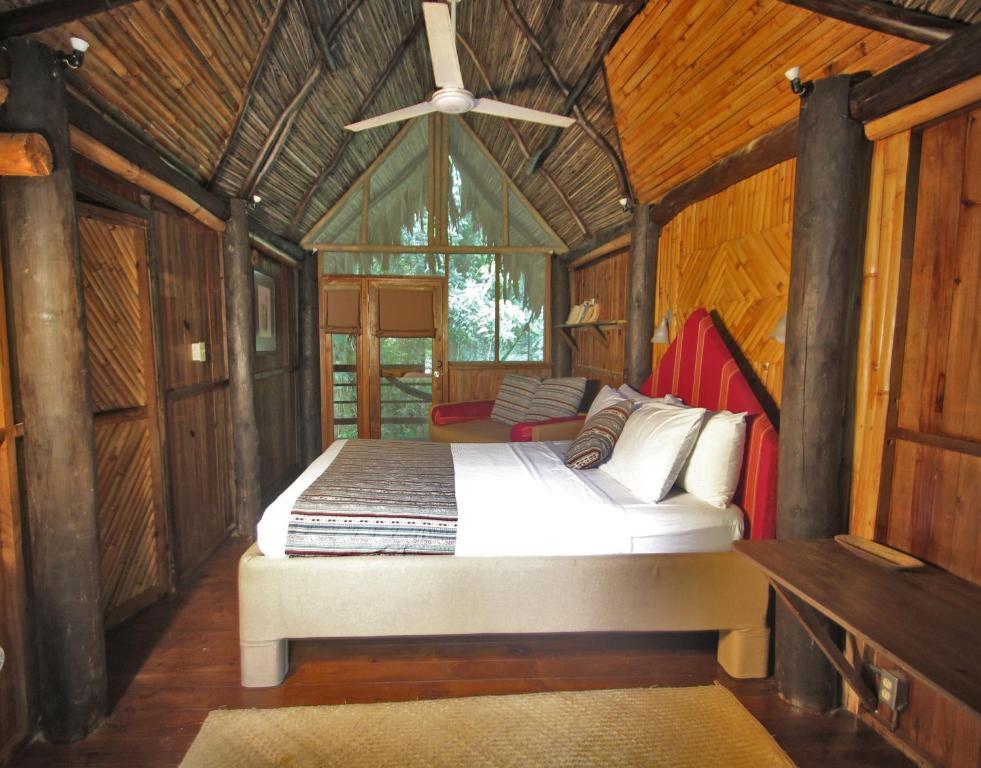 Letto o letti in una camera di Tortugal Boutique River Lodge