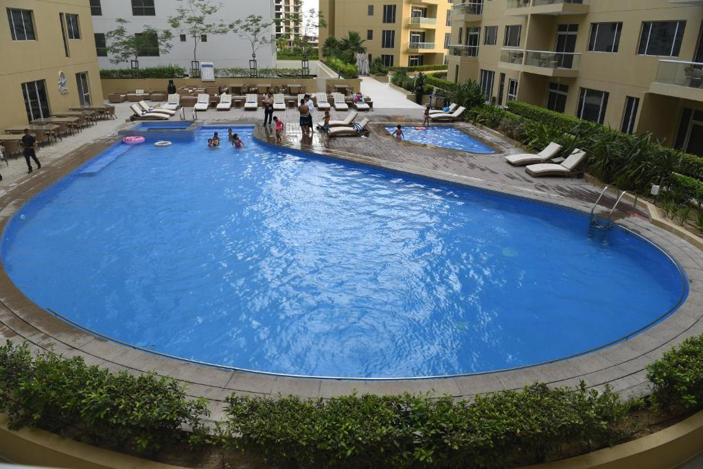 The swimming pool at or near Gulf Suites Hotel Amwaj
