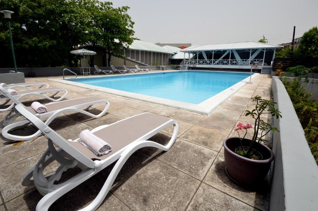 The swimming pool at or close to The Liguanea Club