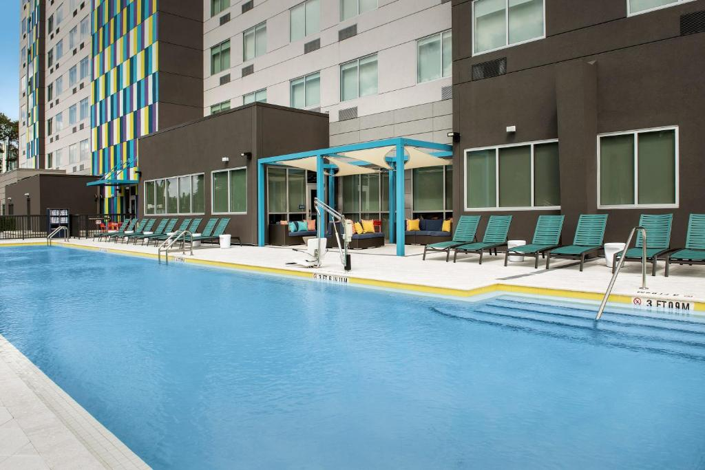 The swimming pool at or near Tru By Hilton Orlando Convention Center