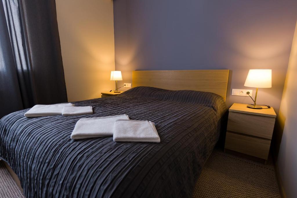 Кровать или кровати в номере Гостиница Соловей