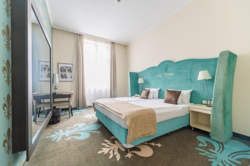 Кровать или кровати в номере La Prima Fashion Hotel Budapest