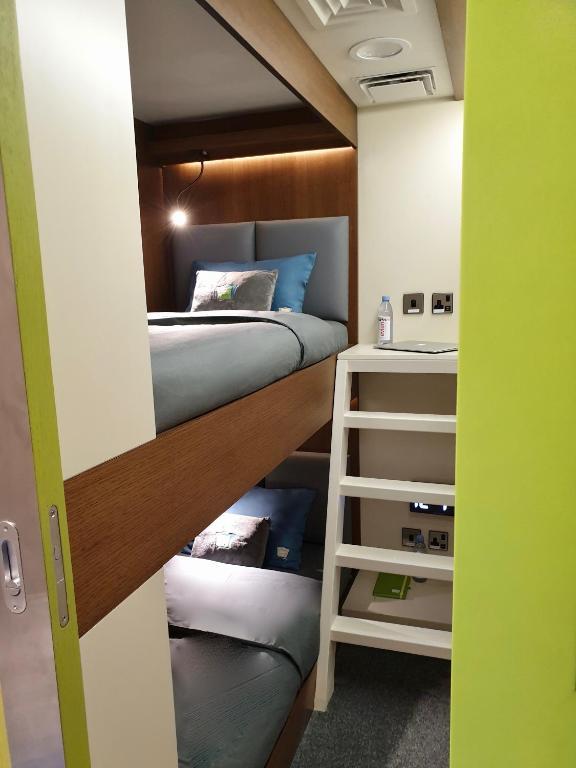 A room with bunk beds at the sleep 'n fly sleep Lounge.