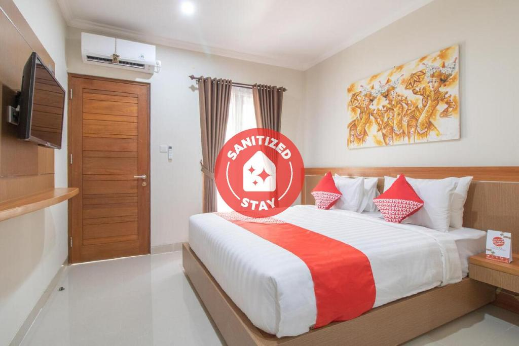 A bed or beds in a room at OYO 3018 Vin Stay