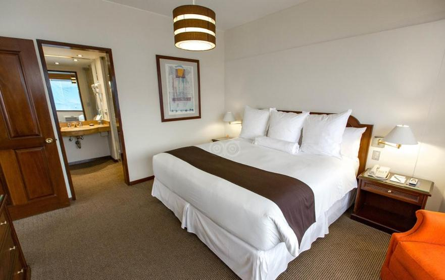 A bed or beds in a room at J&A Classic Hotel