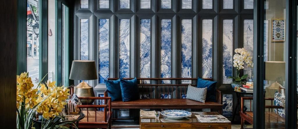 Ein Sitzbereich in der Unterkunft Oriental Heritage Residence