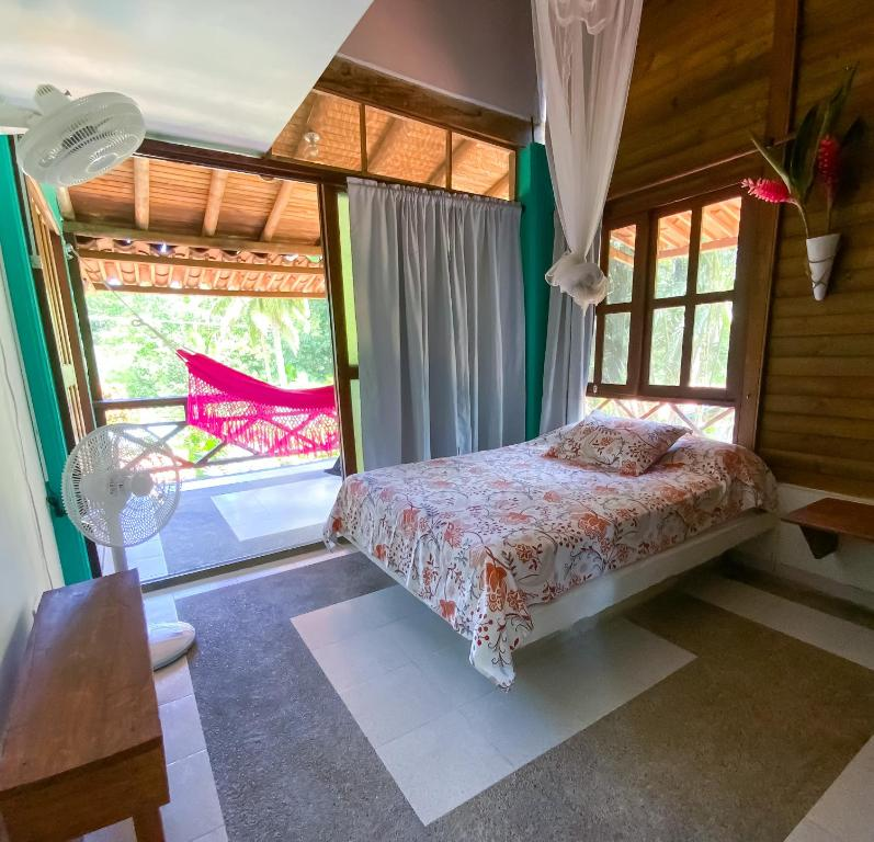 A bed or beds in a room at Los Robles Capurgana