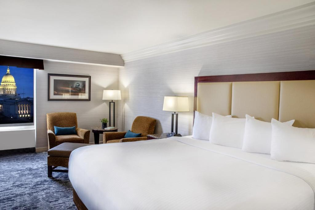 A bed or beds in a room at The Madison Concourse Hotel