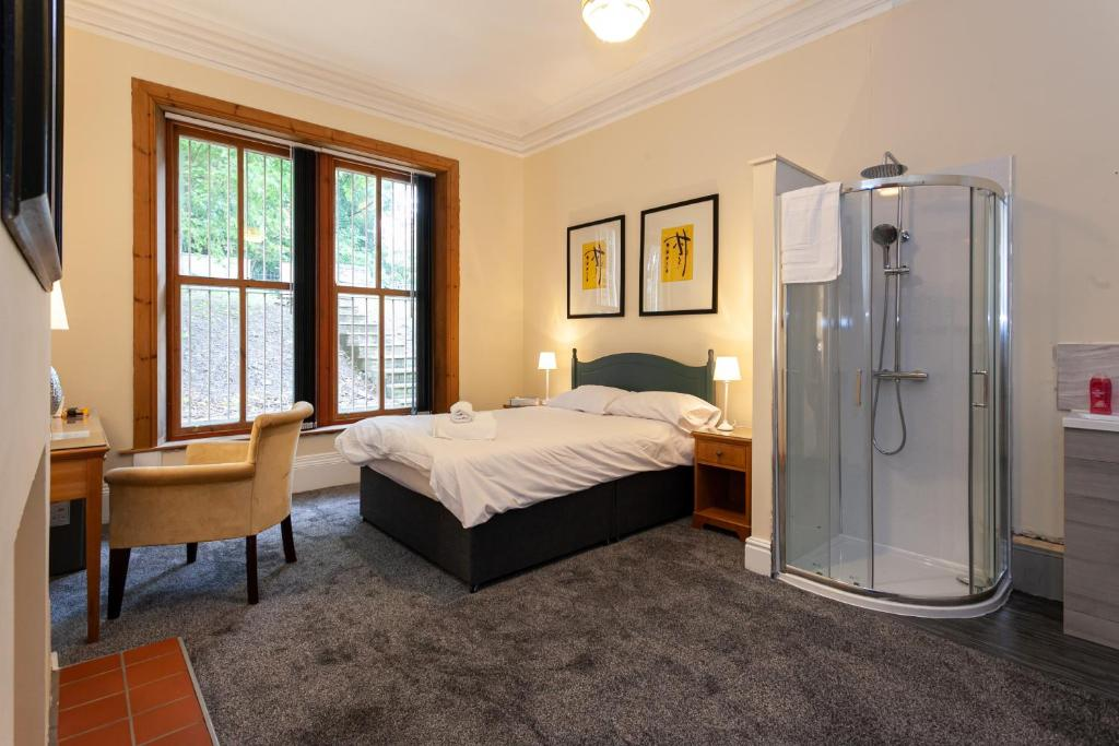 A bed or beds in a room at Townhouse No 12