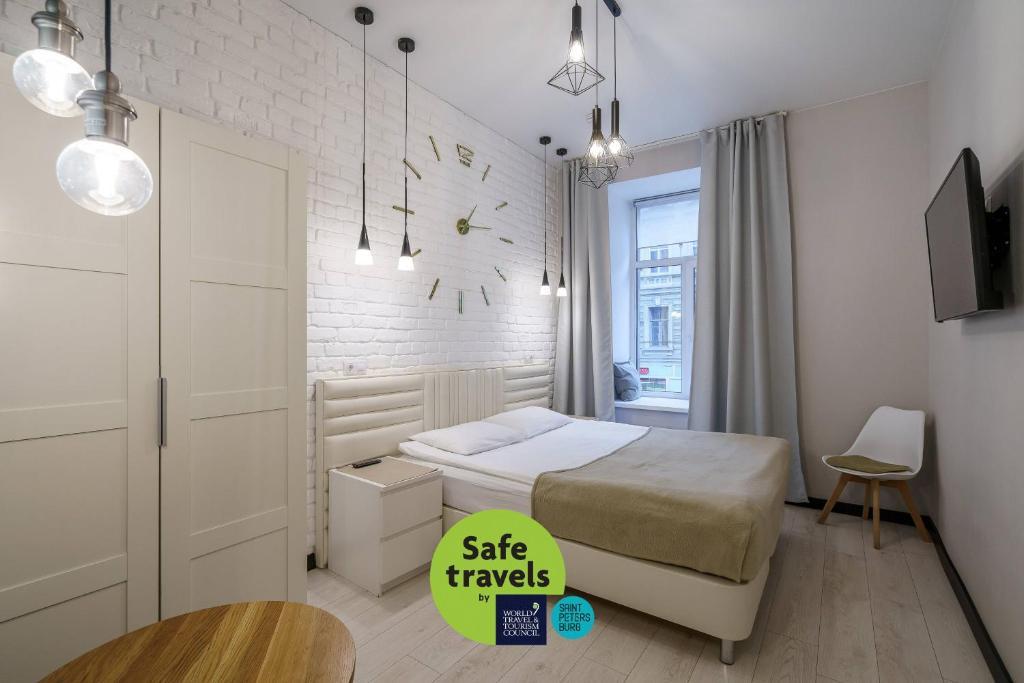Кровать или кровати в номере Adam`s House