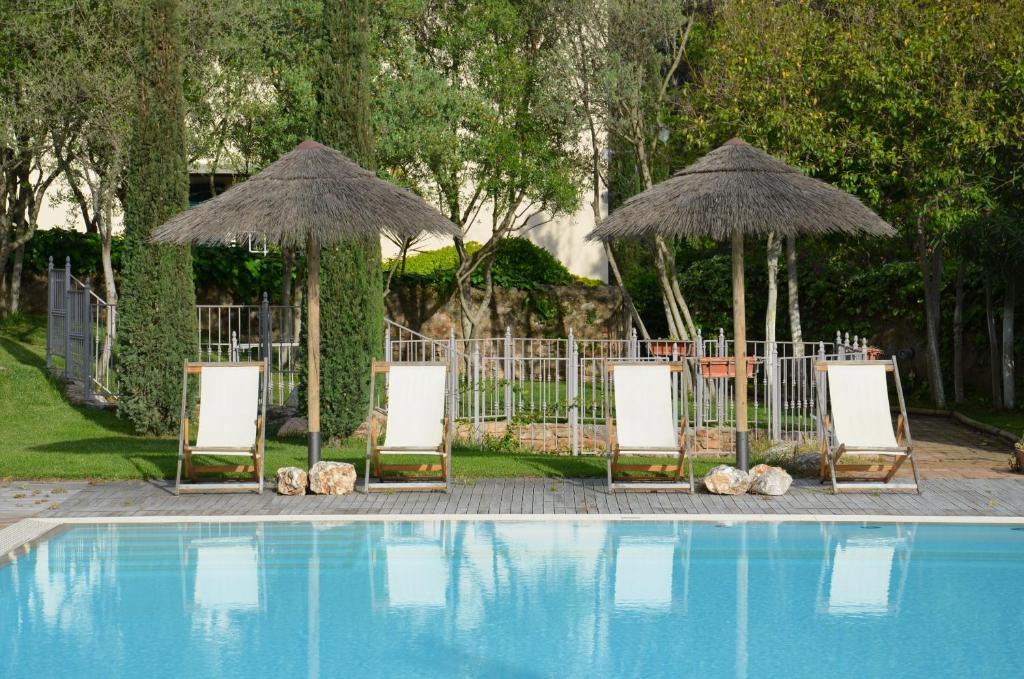 The swimming pool at or near Villa Terme Di Caldana B&B