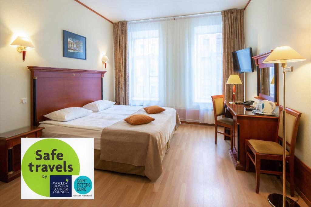 Кровать или кровати в номере Отель «Кристофф»