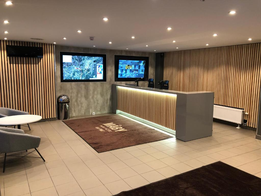 The lobby or reception area at Måby Park & Hotell