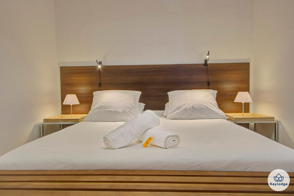 Un ou plusieurs lits dans un hébergement de l'établissement Padam*** - 69m² - Vue sur la mer - Sainte-Marie