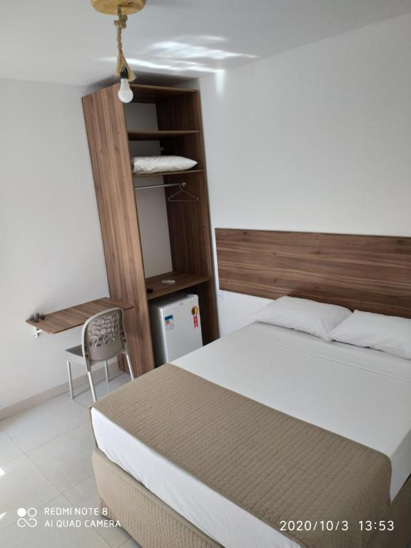 A bed or beds in a room at Pousada Verçosa