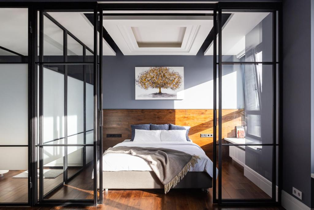 A bed or beds in a room at Loft deluxe APT