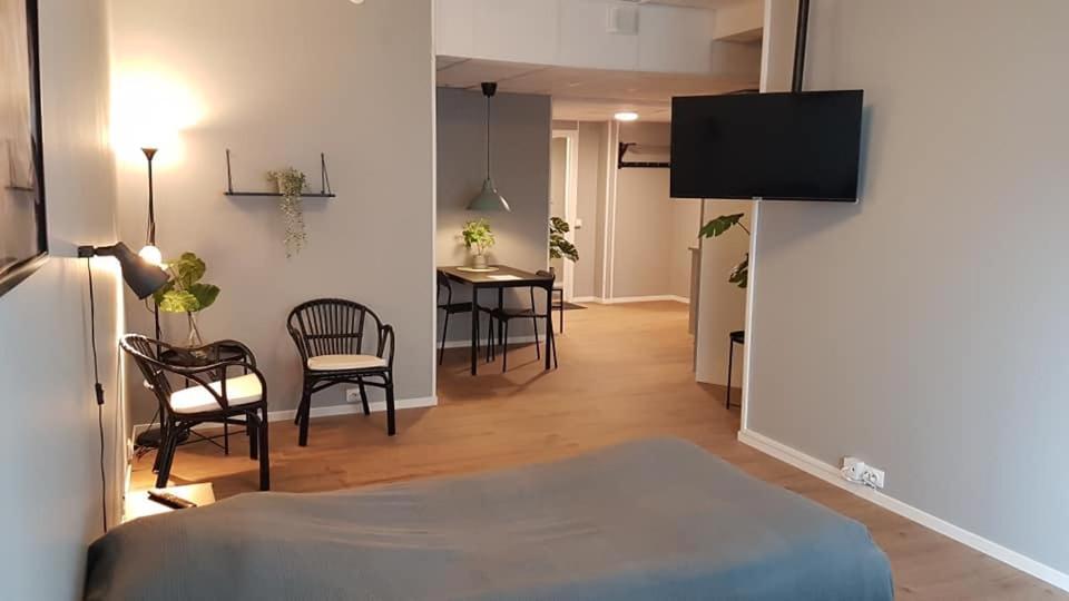 En tv och/eller ett underhållningssystem på Apartments Uppsala - Portalgatan