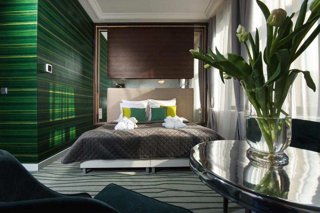 Un ou plusieurs lits dans un hébergement de l'établissement Plaza Boutique Hotel