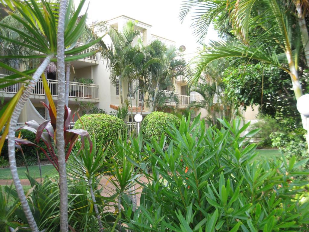 A garden outside San Delles Apartments