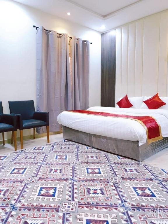 Cama ou camas em um quarto em شقق فندقية سبيل