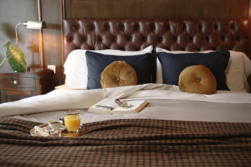 A bed or beds in a room at Vinnhaus