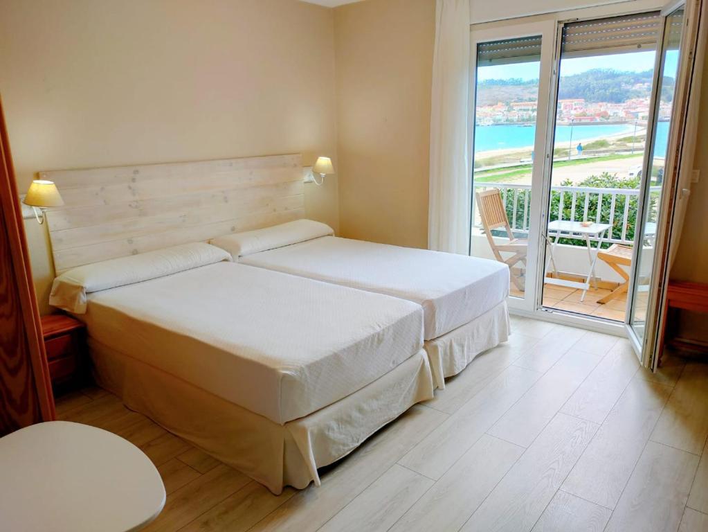Cama o camas de una habitación en Rodeiramar 2A