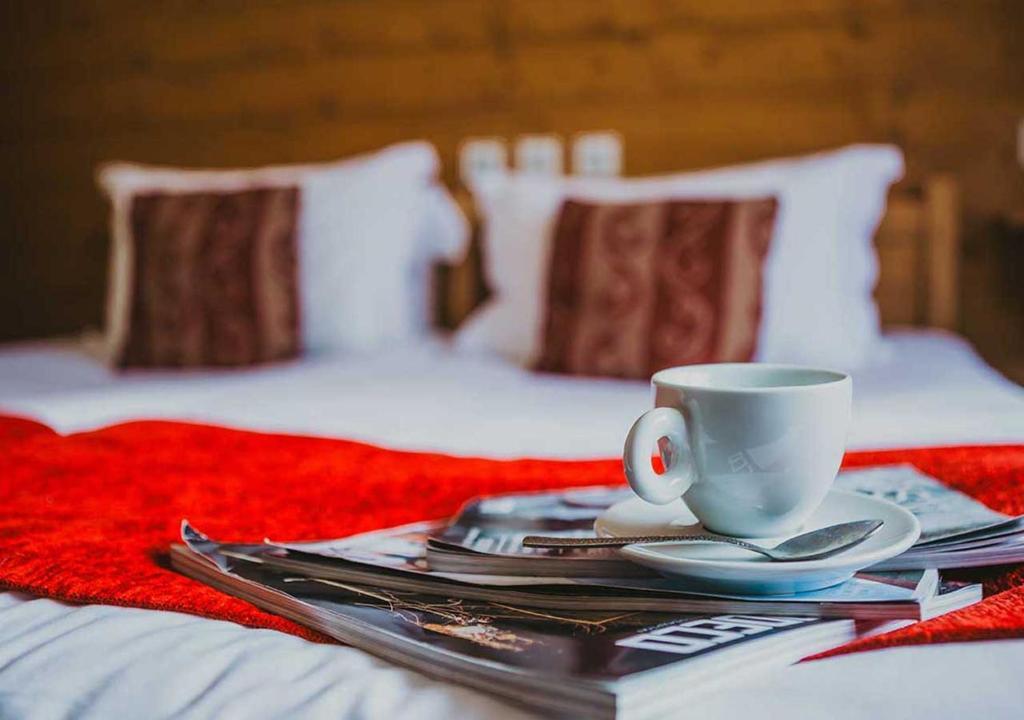A bed or beds in a room at Hôtel Les Grangettes