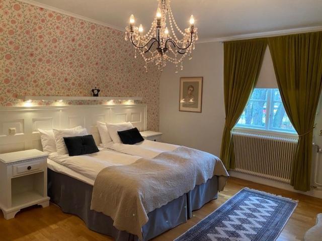 Säng eller sängar i ett rum på Slottshotellet