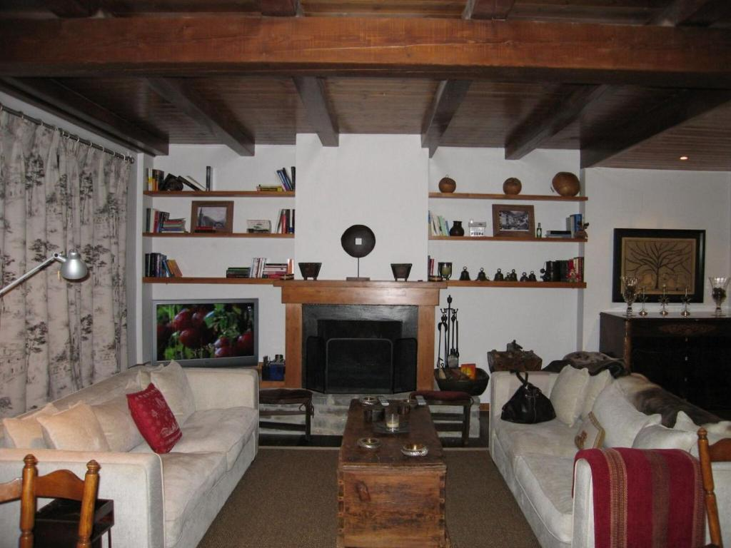 A seating area at Pleasant Holiday Home in Tredos near Ski Area