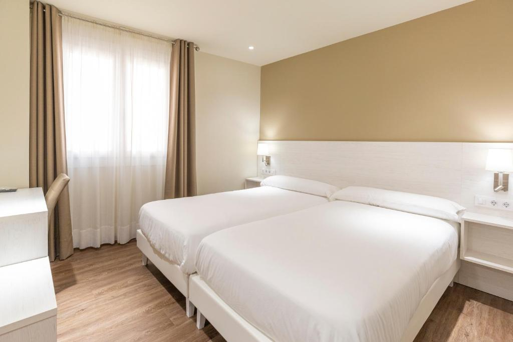 A bed or beds in a room at Hotel La Terraza