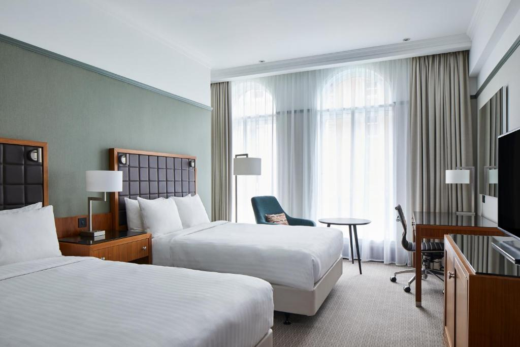 A bed or beds in a room at Leeds Marriott Hotel