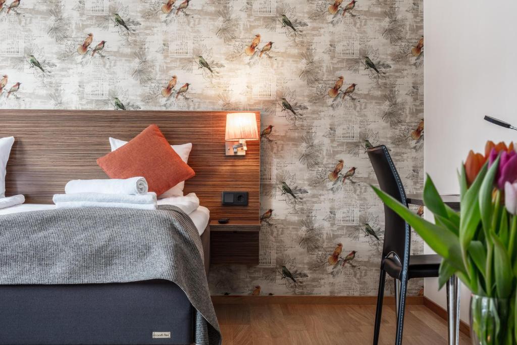 Säng eller sängar i ett rum på SPiS Hotell Naran