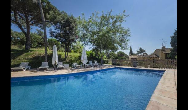 The swimming pool at or near Estanyol Villa Sleeps 14 with Pool